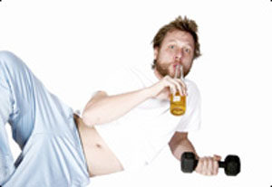 A man lifting weights while drinking beer.
